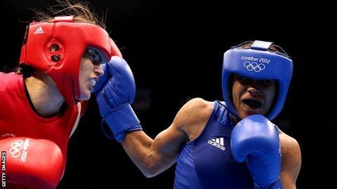 Natasha Jonas fights Katie Taylor at the London Olympics