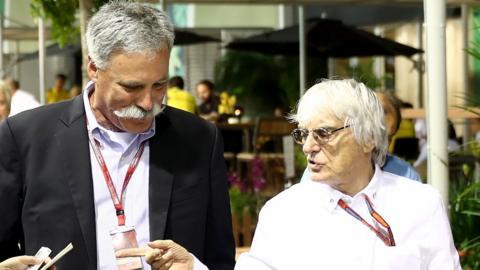 Chase Carey and Bernie Ecclestone