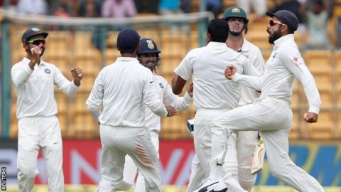 India celebrate the wicket of Mitchell Marsh