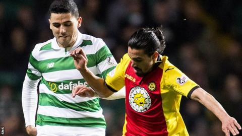 Celtic's Tom Rogic and Partick Thistle's Ryan Edwards contest a ball
