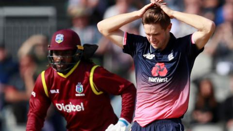 Chris Woakes reacts