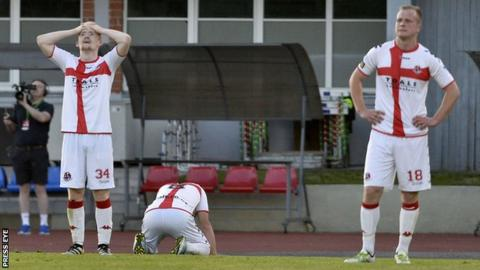 Crusaders players show their huge disappointment after their Europa League exit