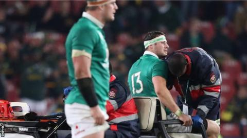 An injured Robbie Henshaw prepares to leave the action in Johannesburg