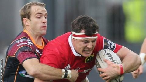 Robin Copeland of Munster is tackled by Sarel Pretorius