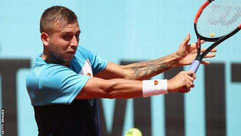 Dan Evans' French Open debut ends in defeat by Tommy Robredo