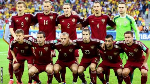 Russia pose for a team photo before their 2014 group game against Algeria