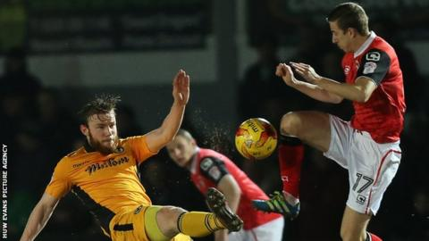 Mark O'Brien of Newport County challenges Andrew Fleming of Morecambe for the ball