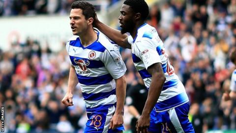Yann Kermorgant celebrates his goal for Reading against Wigan