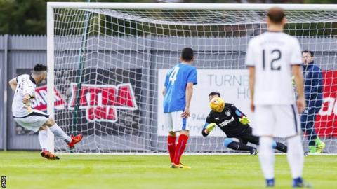 Callum Gallagher scores a penalty