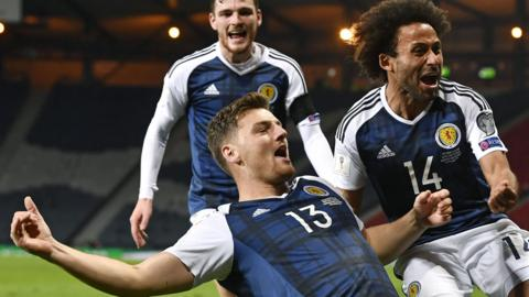 Chris Martin celebrates his winner for Scotland