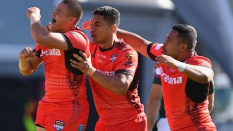 Tonga celebrate scoring a try - but they were hanging on at the end
