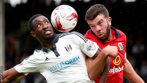Moussa Dembele in action for Fulham against Blackburn Rovers' Grant Hanley