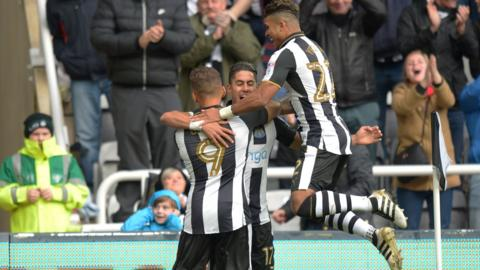 Newcastle's players celebrate Ayoze Perez's early goal against Ipswich