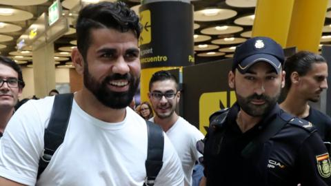 Diego Costa was given a police escort after landing in Madrid