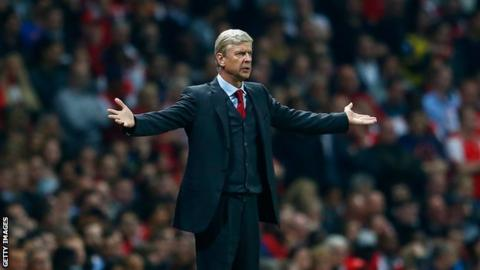 Arsene Wenger gesticulating on the touchline