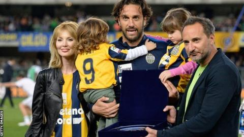 Luca Toni receives an award to mark his retirement