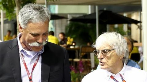 Chase Carey and Bernie Ecclestone