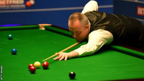 Higgins beats Gould to reach round two at Crucible
