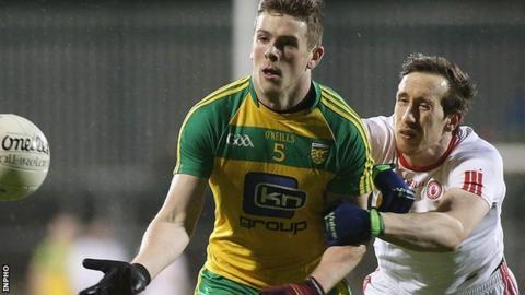 Donegal's Eoghan Ban Gallagher gets a tug from Tyrone midfielder Colm Cavanagh in Ballybofey