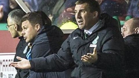 Alan Stubbs looks frustrated as he watches Hibs draw 2-2 with Falkirk on Tuesday