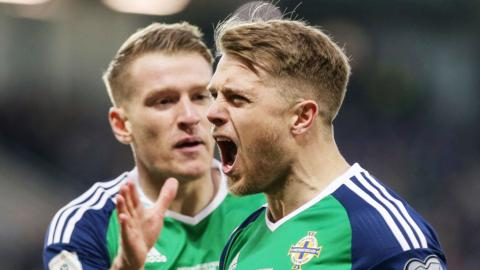 Jamie Ward celebrates after putting Northern Ireland ahead against Norway as he is about to be congratulated by Steven Davis