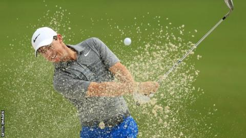 Rory McIlroy splashes out of a bunker during practice for the US PGA Championship