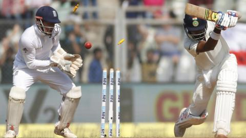 India's KL Rahul is bowled by Moeen Ali