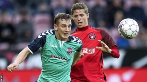 Derry City's Ronan Curtis and Andre Roemer of Midtjylland vie for possession at the MCH Arena