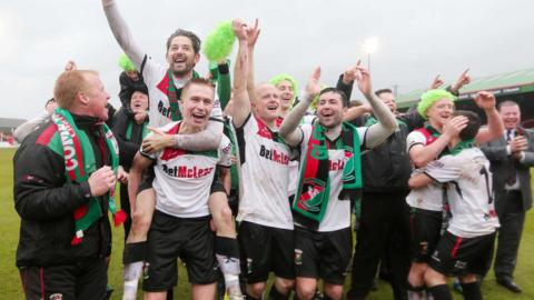 Glentoran players celebrate after beating Portadown in the Irish Cup final at the Oval in May