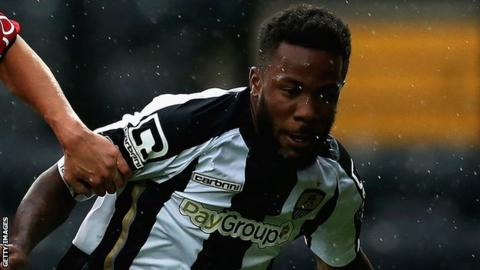 Mustapha Dumbuya playing for Notts County