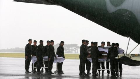 Coffins containing the mortal remains of the victims of the plane crash in Colombia arrive in Chapeco, Brazil December 3, 2016