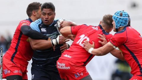 Nick Williams crashes into three Bristol defenders on his debut for Cardiff Blues