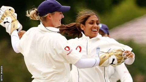 Isa Guya and wicketkeeper Jane Smit celebrate a wicket at Bowral in 2008
