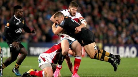 Ulster's Stuart McCloskey tackles Wasps fly-half Jimmy Gopperth