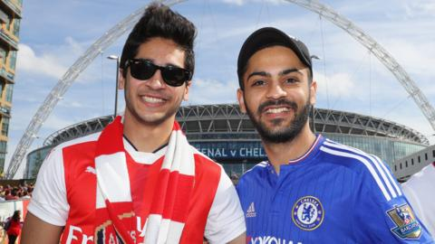 An Arsenal and Chelsea fan stand together