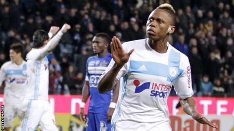 Clinton Njie celebrates scoring for Marseille