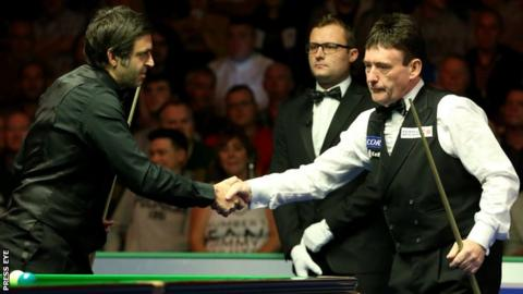 Ronnie O'Sullivan and Jimmy White shake hands before their encounter in Belfast on Wednesday