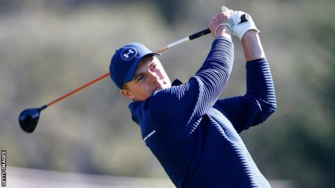 Suspended second round ends with Day, Spieth tied for lead