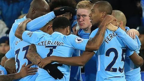Manchester City players celebrate scoring against Leicester