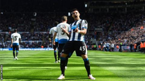 Serbian forward Alexsandar Mitrovic celebrates a goal against Tottenham at St James' Park.
