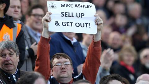 Newcastle fan protests against Mike Ashley