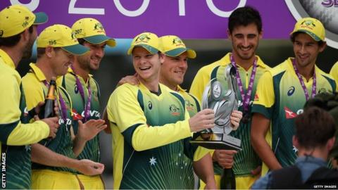 Steve Smith and the Australia team celebrate with the Trophy after victory in the 5th Royal London One-Day International match between England and Australia at Old Trafford on September 13, 2015 in Manchester, United Kingdom