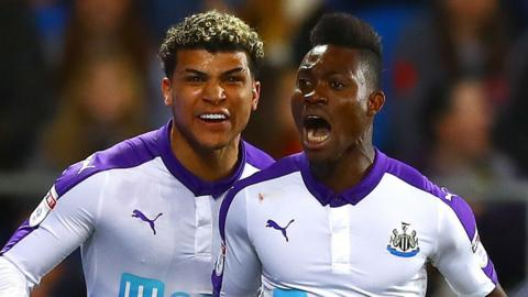 Christian Atsu celebrates after scoring Newcastle's opening goal.