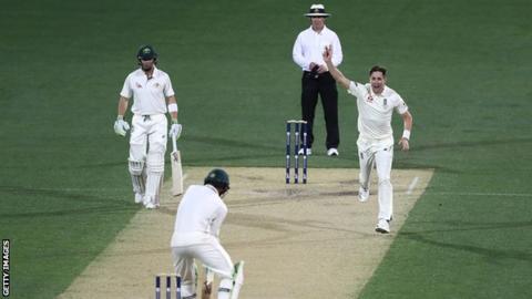 Chris Woakes celebrates a wicket