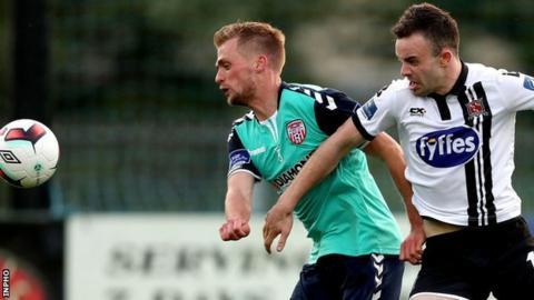 Derry midfielder Lucas Schubert gets in front of Dundalk's Robbie Benson