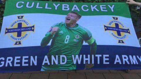 Northern Ireland fans from Cullybackey show their support for NI's number eight Steven Davis