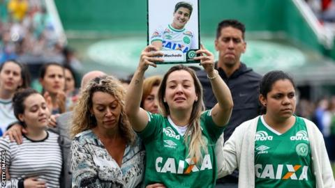 Supporters and family pay tribute to the deceased