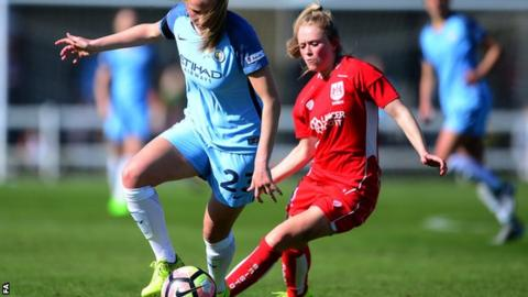 Abbie McManus of Manchester City Women (left) looks to break past Millie Farrow of Bristol City Women