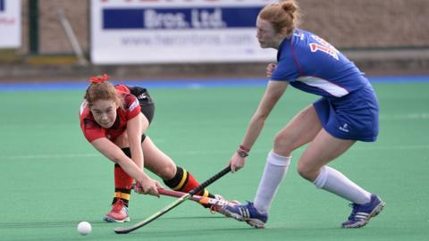 Banbridge's Gina Woods in action against Ursuline's Jill Shanahan during the final game of the Championship