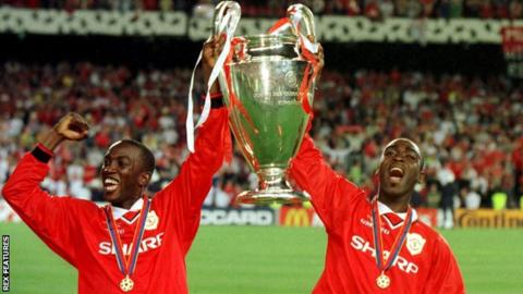 Dwight Yorke (left) and Andy Cole celebrate after helping Manchester United win the Champions League in 1999